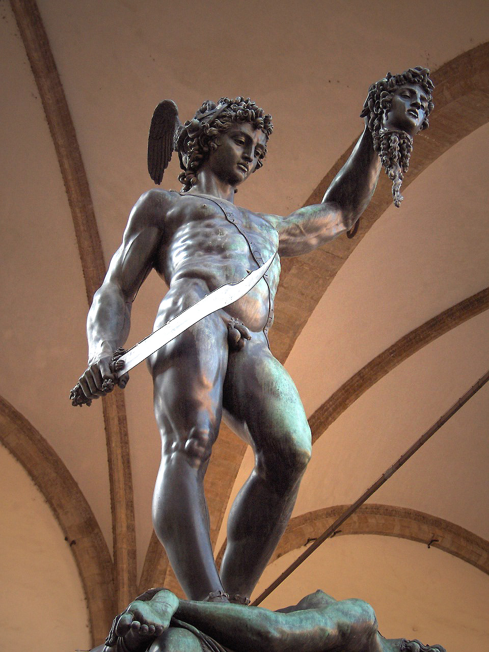 A Renaissance sculpture of Perseus holding the head of Medussa
